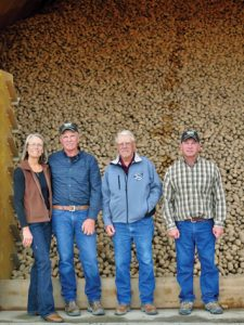 Cottom Seed is a family enterprise operated by Steve and his wife, Cathy; his brother, David; and their father, Bill. Pictured in front of freshly piled Generation III Ranger Russet seed are Cathy, Steve, Bill and David Cottom. Photo by Cottom Seed