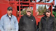From left, Chuy Olivas, Jeremy Arnold and Eric Arnold take a quick break during harvest in Teton County.