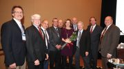 Colleagues congratulate NPC's 2018 Potato Woman of the Year Melanie Wickham, executive director of the Empire State Potato Growers Association (center). Pictured from left to right are Chris Voigt, Bill Brewer, Mike Wenkel, Chuck Gunnerson, Frank Muir, Melanie Wickham, Jim Ehrlich, Pat Kole, John Keeling and Tamas Houlihan.